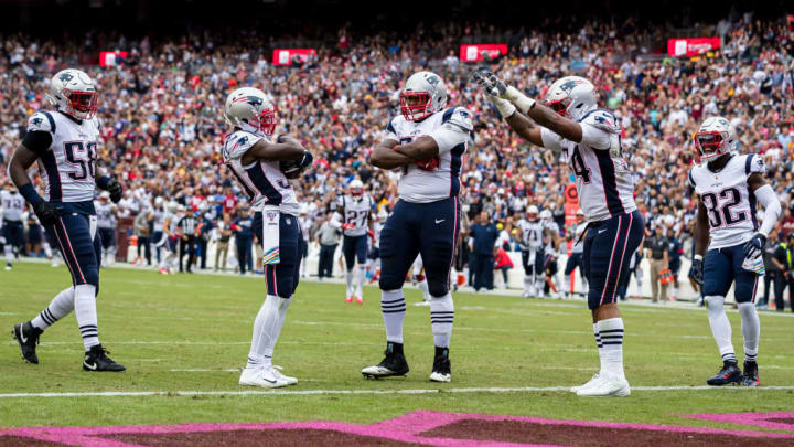 LANDOVER, MD - OCTOBER 06: Jason McCourty #30 of the New England Patriots celebrates with teammates after intercepting a pass during the first half at FedExField on October 6, 2019 in Landover, Maryland. (Photo by Scott Taetsch/Getty Images)