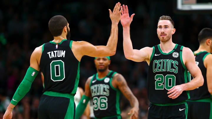 Boston's Jayson Tatum high-fives teammate Gordon Hayward after a big play vs. New Orleans