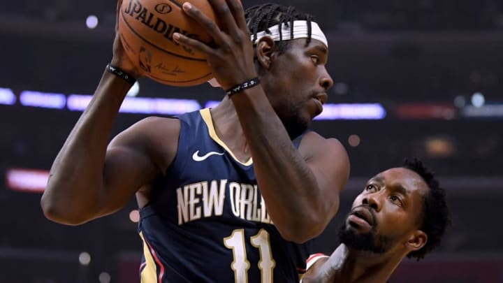LOS ANGELES, CALIFORNIA - JANUARY 14:  Jrue Holiday #11 of the New Orleans Pelicans is guarded by Patrick Beverley #21 of the LA Clippers during the first half at Staples Center on January 14, 2019 in Los Angeles, California. (Photo by Harry How/Getty Images)