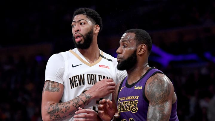 LOS ANGELES, CALIFORNIA - DECEMBER 21:  LeBron James #23 of the Los Angeles Lakers guards Anthony Davis #23 of the New Orleans Pelicans during a 112-104 Laker win at Staples Center on December 21, 2018 in Los Angeles, California.  NOTE TO USER: User expressly acknowledges and agrees that, by downloading and or using this photograph, User is consenting to the terms and conditions of the Getty Images License Agreement. (Photo by Harry How/Getty Images)