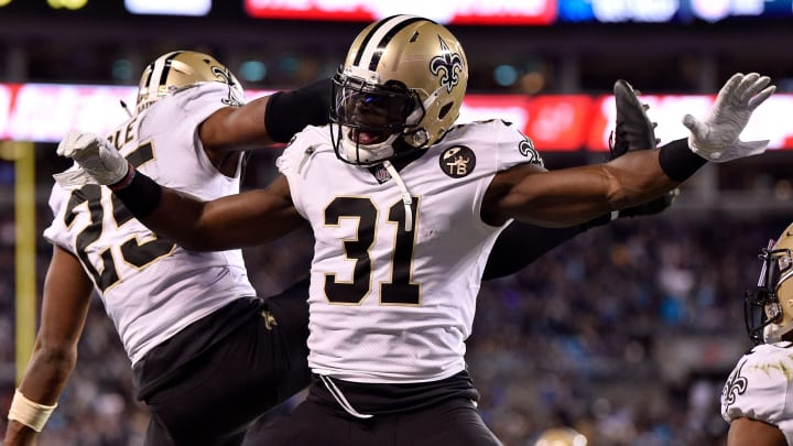 CHARLOTTE, NC - DECEMBER 17:  Chris Banjo #31 and teammate Eli Apple #25 of the New Orleans Saints celebrate an interception against the Carolina Panthers in the second quarter during their game at Bank of America Stadium on December 17, 2018 in Charlotte, North Carolina.  (Photo by Grant Halverson/Getty Images)