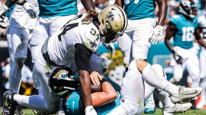 JACKSONVILLE, FLORIDA - OCTOBER 13: Cameron Jordan #94 of the New Orleans Saints tackles Gardner Minshew II #15 of the Jacksonville Jaguars in the 3rd quarter at TIAA Bank Field on October 13, 2019 in Jacksonville, Florida. (Photo by Harry Aaron/Getty Images)