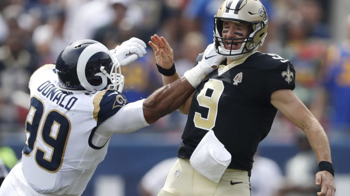 LOS ANGELES, CALIFORNIA - SEPTEMBER 15:  Drew Brees #9 of the New Orleans Saints injures his throwing hand as he is hit by Aaron Donald #99 of the Los Angeles Rams during the first quarter in the gameat Los Angeles Memorial Coliseum on September 15, 2019 in Los Angeles, California. (Photo by Sean M. Haffey/Getty Images)
