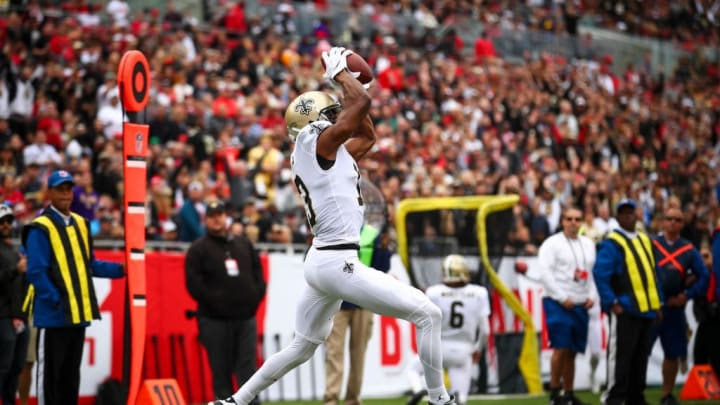 TAMPA, FLORIDA - NOVEMBER 17: Michael Thomas #13 of the New Orleans Saints pulls down the pass from Drew Brees #9 for a touchdown in the first quarter of the game against the Tampa Bay Buccaneers on November 17, 2019 at Raymond James Stadium in Tampa, Florida. (Photo by Will Vragovic/Getty Images)