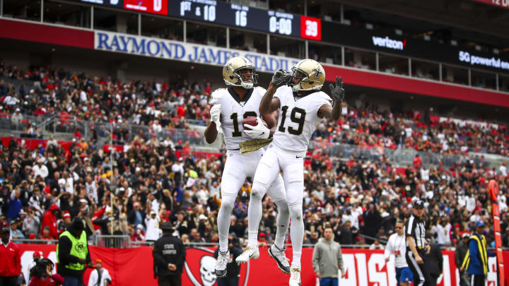 TAMPA, FLORIDA - NOVEMBER 17: Michael Thomas #13 of the New Orleans Saints celebrates after a touchdown with Ted Ginn #19 in the first quarter of the game against the Tampa Bay Buccaneers on November 17, 2019 at Raymond James Stadium in Tampa, Florida. (Photo by Will Vragovic/Getty Images)