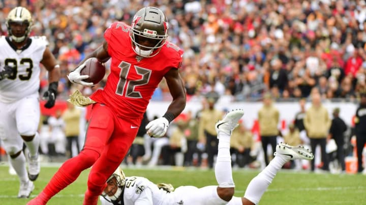 TAMPA, FLORIDA - NOVEMBER 17: Chris Godwin #12 of the Tampa Bay Buccaneers catches a 30-yard touchdown pass during the third quarter of a football game against the New Orleans Saints at Raymond James Stadium on November 17, 2019 in Tampa, Florida. (Photo by Julio Aguilar/Getty Images)