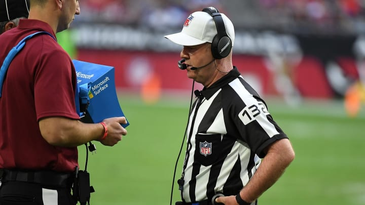 A referee looks at a replay review.