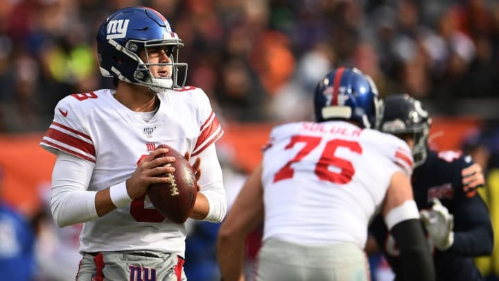 CHICAGO, ILLINOIS - NOVEMBER 24:  Daniel Jones #8 of the New York Giants looks to pass during a game against the Chicago Bears at Soldier Field on November 24, 2019 in Chicago, Illinois.  The Bears defeated the Giants 19-14.  (Photo by Stacy Revere/Getty Images)