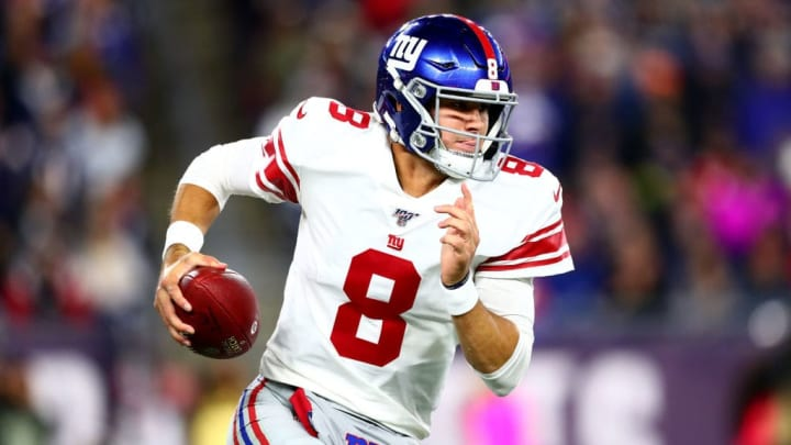 FOXBOROUGH, MASSACHUSETTS - OCTOBER 10: Daniel Jones #8 of the New York Giants runs with the ball against the New England Patriots during the first quarter in the game at Gillette Stadium on October 10, 2019 in Foxborough, Massachusetts. (Photo by Adam Glanzman/Getty Images)