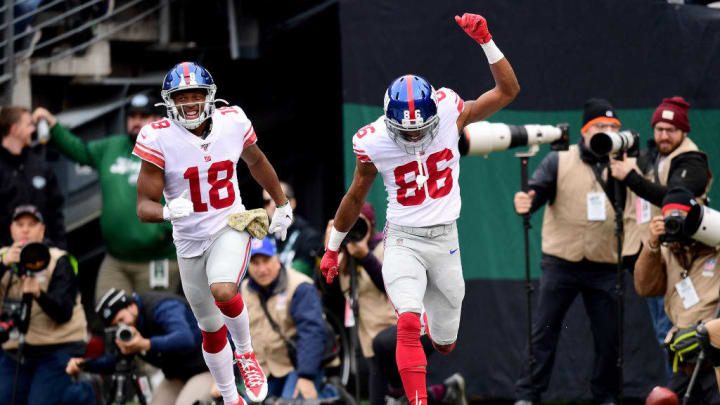 EAST RUTHERFORD, NEW JERSEY - NOVEMBER 10: Darius Slayton #86 and Bennie Fowler #18 of the New York Giants celebrate a touchdown in the first half of their game against the New York Jets at MetLife Stadium on November 10, 2019 in East Rutherford, New Jersey. (Photo by Emilee Chinn/Getty Images)