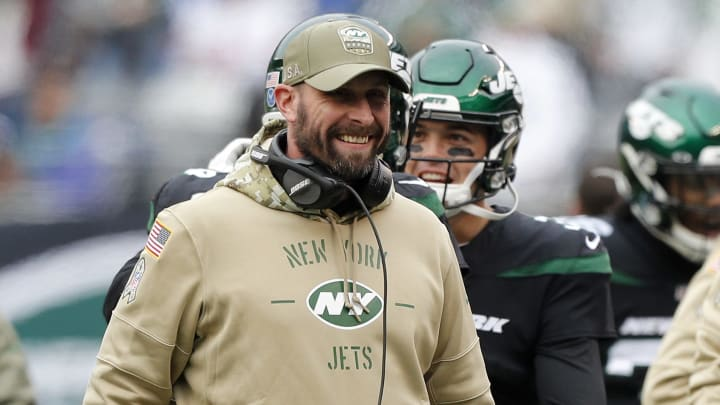 Adam Gase laughing at Jets fans.
