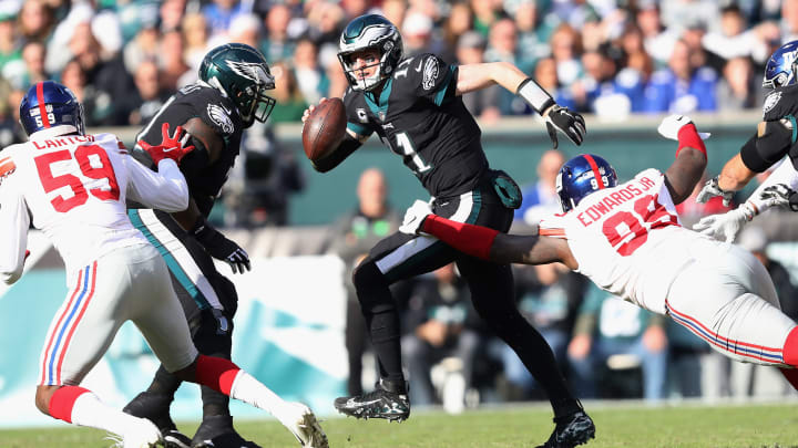PHILADELPHIA, PA - NOVEMBER 25: Quarterback Carson Wentz #11 of the Philadelphia Eagles is sacked by defensive end Mario Edwards #99 of the New York Giants during the first quarter at Lincoln Financial Field on November 25, 2018 in Philadelphia, Pennsylvania.  (Photo by Elsa/Getty Images)