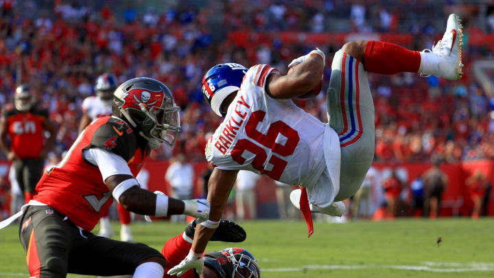 TAMPA, FLORIDA - SEPTEMBER 22: Running back Saquon Barkley #26 of the New York Giants runs the ball against cornerback M.J. Stewart #36 of the Tampa Bay Buccaneers in theduring the game at Raymond James Stadium on September 22, 2019 in Tampa, Florida. (Photo by Mike Ehrmann/Getty Images)
