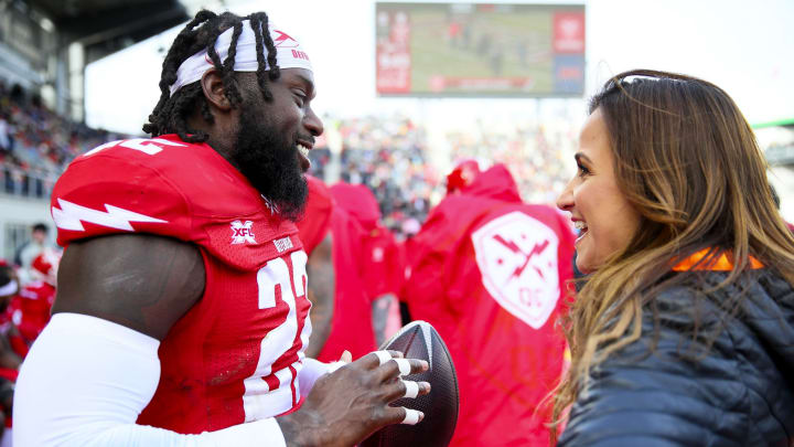 Dianna Russini working as a sideline reporter.