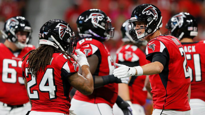 ATLANTA, GEORGIA - AUGUST 15:  Matt Ryan #2 converses with Devonta Freeman #24 of the Atlanta Falcons against the New York Jets during the first half of the preseason game at Mercedes-Benz Stadium on August 15, 2019 in Atlanta, Georgia. (Photo by Kevin C. Cox/Getty Images)