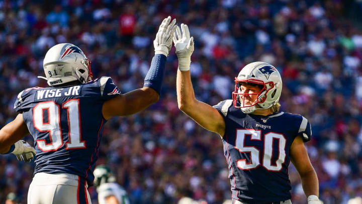 FOXBOROUGH, MA - SEPTEMBER 22:  Deatrich Wise Jr. #91 and Chase Winovich #50 of the New England Patriots high five during the fourth quarter of a game against the New York Jets at Gillette Stadium on September 22, 2019 in Foxborough, Massachusetts. (Photo by Billie Weiss/Getty Images)