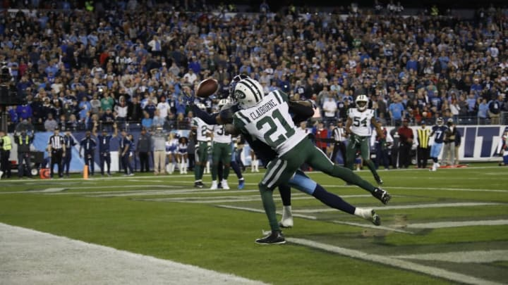 NASHVILLE, TN - DECEMBER 2: Tajae Sharpe #19 of the Tennessee Titans dives trying to catch a pass from Marcus Mariota #8 while defended by Morris Claiborne #21 of the New York Jets during the fourth quarter at Nissan Stadium on December 2, 2018 in Nashville, Tennessee. (Photo by Frederick Breedon/Getty Images)