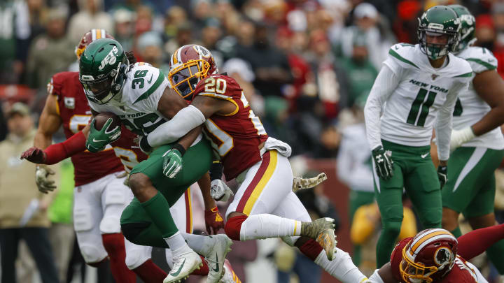 LANDOVER, MD - NOVEMBER 17: Josh Adams #36 of the New York Jets is tackled by Landon Collins #20 of the Washington Redskins during the first half at FedExField on November 17, 2019 in Landover, Maryland. (Photo by Scott Taetsch/Getty Images)