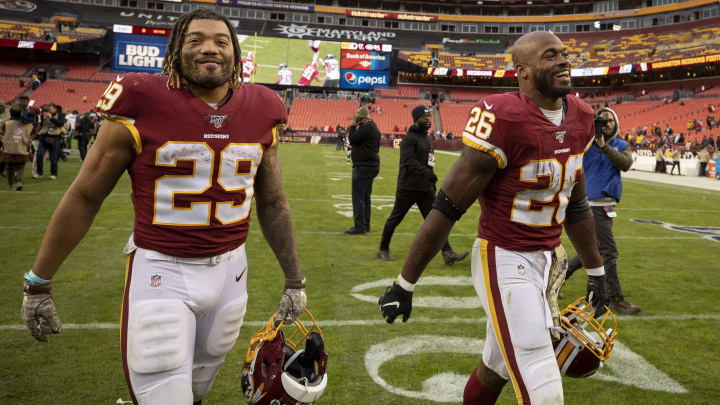 Derrius Guice (L) and Adrian Peterson (R) walking off the field
