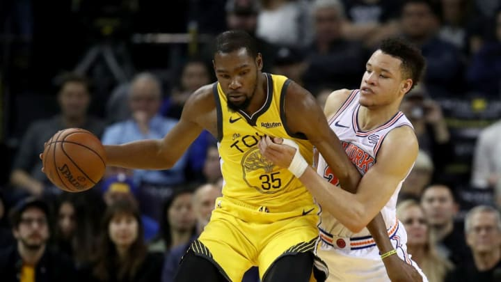OAKLAND, CALIFORNIA - JANUARY 08:  Kevin Durant #35 of the Golden State Warriors is guarded by Kevin Knox #20 of the New York Knicks at ORACLE Arena on January 08, 2019 in Oakland, California. NOTE TO USER: User expressly acknowledges and agrees that, by downloading and or using this photograph, User is consenting to the terms and conditions of the Getty Images License Agreement. (Photo by Ezra Shaw/Getty Images)