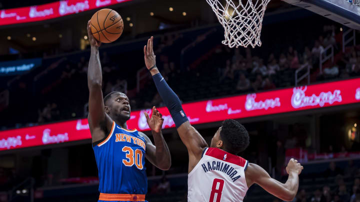 WASHINGTON, DC - OCTOBER 07: Julius Randle #30 of the New York Knicks shoots against Rui Hachimura #8 of the Washington Wizards during the first half at Capital One Arena on October 7, 2019 in Washington, DC. NOTE TO USER: User expressly acknowledges and agrees that, by downloading and or using this photograph, User is consenting to the terms and conditions of the Getty Images License Agreement. (Photo by Scott Taetsch/Getty Images)