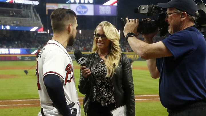 Kelsey Wingert, center, doing a postgame interview.