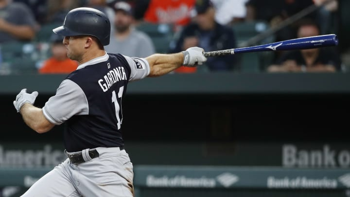 BALTIMORE, MD - AUGUST 25: Brett Gardner #11 of the New York Yankees grounds into a fielder's choice scoring Austin Romine #28 (not pictured) in the second inning against the Baltimore Orioles during game two of a doubleheader at Oriole Park at Camden Yards on August 25, 2018 in Baltimore, Maryland.  All players across MLB will wear nicknames on their backs as well as colorful, non-traditional uniforms featuring alternate designs inspired by youth-league uniforms during Players Weekend. (Photo by Patrick McDermott/Getty Images)