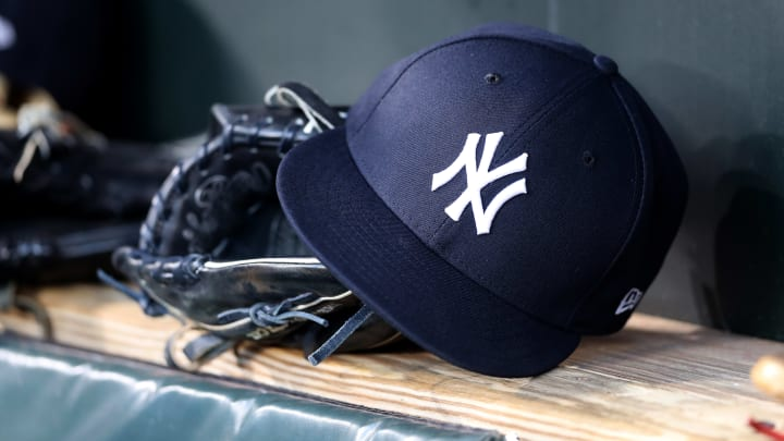 BALTIMORE, MARYLAND - APRIL 06: A New York Yankees hat and glove sit in the dugout before the start of the Yankees and Baltimore Orioles game  at Oriole Park at Camden Yards on April 06, 2019 in Baltimore, Maryland. (Photo by Rob Carr/Getty Images)