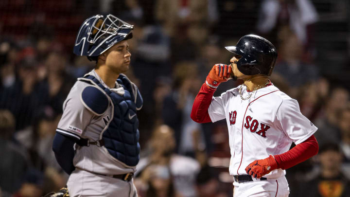 BOSTON, MA - SEPTEMBER 8: Mookie Betts #50 of the Boston Red Sox reacts as Gary Sanchez #24 of the New York Yankees looks on after hitting a solo home run during the eighth inning of a game on September 8, 2019 at Fenway Park in Boston, Massachusetts. (Photo by Billie Weiss/Boston Red Sox/Getty Images)