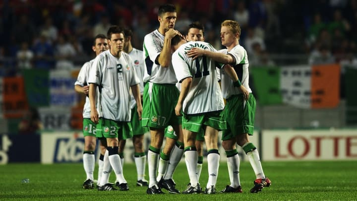Nialll Quinn and Damien Duff of the Republic of Ireland console team-mate Kevin Kilbane after he missed a penalty in the shoot-out