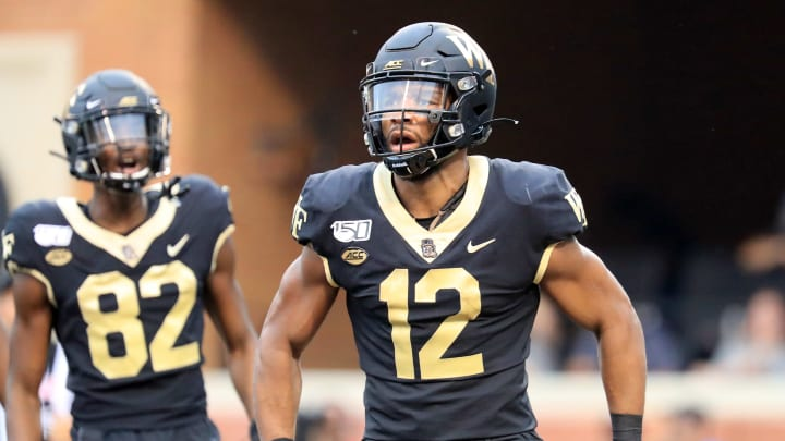 WINSTON SALEM, NORTH CAROLINA - SEPTEMBER 13: Jamie Newman #12 of the Wake Forest Demon Deacons reacts after scoring a touchdown against the North Carolina Tar Heels during their game at BB&T Field on September 13, 2019 in Winston Salem, North Carolina. (Photo by Streeter Lecka/Getty Images)