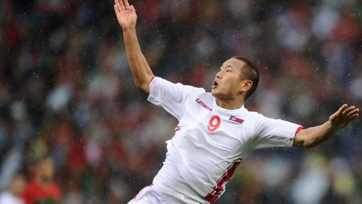 North Korea's defender Jong Tae-Se jumps
