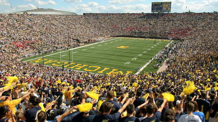 ANN ARBOR - SEPTEMBER 3:  Michigan fans cheer prior to the start of the home opener against Northern Illinois at Michigan Stadium on September 3, 2005 in Ann Arbor, Michigan.  (Photo by Tom Pidgeon/Getty Images)
