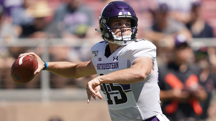 PALO ALTO, CA - AUGUST 31:  Hunter Johnson #15 of the Northwestern Wildcats drops back to pass against the Stanford Cardinal during the first quarter of an NCAA football game at Stanford Stadium on August 31, 2019 in Palo Alto, California.  (Photo by Thearon W. Henderson/Getty Images)