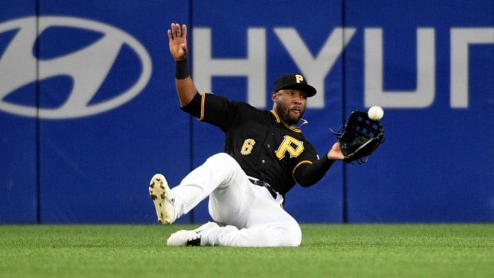 PITTSBURGH, PA - MAY 04: Starling Marte #6 of the Pittsburgh Pirates makes a sliding catch on a ball off the bat of Stephen Piscotty #25 of the Oakland Athletics in the third inning during the game at PNC Park on May 4, 2019 in Pittsburgh, Pennsylvania. (Photo by Justin Berl/Getty Images)