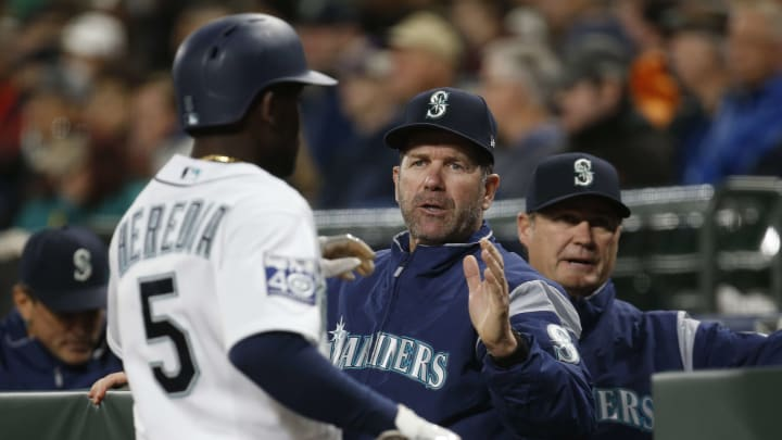 SEATTLE, WA - MAY 15: Seattle Mariners left fielder Guillermo Heredia #5 is greeted by batting coach and former Mariner Edgar Martinez after scoring on a bases loaded walk in the first inning at Safeco Field on May 15, 2017 in Seattle, Washington. (Photo by Lindsey Wasson/Getty Images)