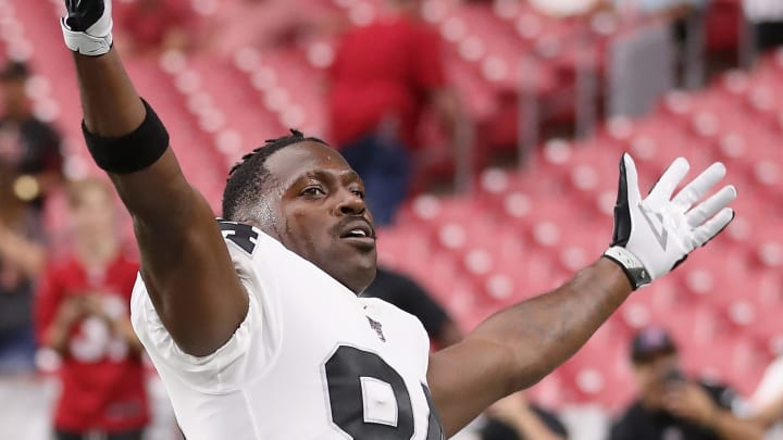 GLENDALE, ARIZONA - AUGUST 15:  Wide receiver Antonio Brown #84 of the Oakland Raiders reacts to fans as he warms up before the NFL preseason game against the Arizona Cardinals at State Farm Stadium on August 15, 2019 in Glendale, Arizona. (Photo by Christian Petersen/Getty Images)