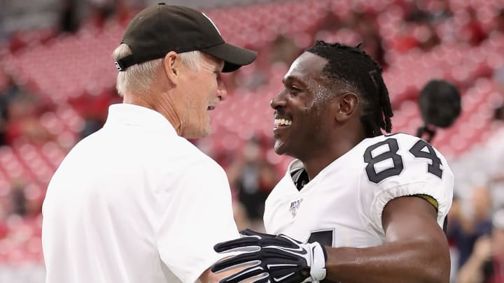 GLENDALE, ARIZONA - AUGUST 15:  Wide receiver Antonio Brown #84 of the Oakland Raiders talks with general manager Mike Mayock before the NFL preseason game against the Arizona Cardinals at State Farm Stadium on August 15, 2019 in Glendale, Arizona. (Photo by Christian Petersen/Getty Images)