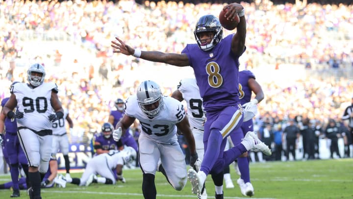 BALTIMORE, MARYLAND - NOVEMBER 25: Quarterback Lamar Jackson #8 of the Baltimore Ravens rushes for a touchdown during the third quarter against the Oakland Raiders at M&T Bank Stadium on November 25, 2018 in Baltimore, Maryland. (Photo by Patrick Smith/Getty Images)