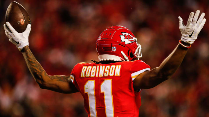 KANSAS CITY, MO - DECEMBER 30:Demarcus Robinson #11 of the Kansas City Chiefs puts his arms up after catching the fiftieth touchdown pass of the season for his quarterback Patrick Mahomes #15 during the third quarter of the game against the Oakland Raiders at Arrowhead Stadium on December 30, 2018 in Kansas City, Missouri. (Photo by David Eulitt/Getty Images)