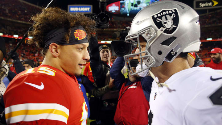KANSAS CITY, MISSOURI - DECEMBER 30:  Quarterback Patrick Mahomes #15 of the Kansas City Chiefs greets quarterback Derek Carr #4 of the Oakland Raiders after the Chiefs defeated the Raiders 35-3 to win the game at Arrowhead Stadium on December 30, 2018 in Kansas City, Missouri. (Photo by Jamie Squire/Getty Images)