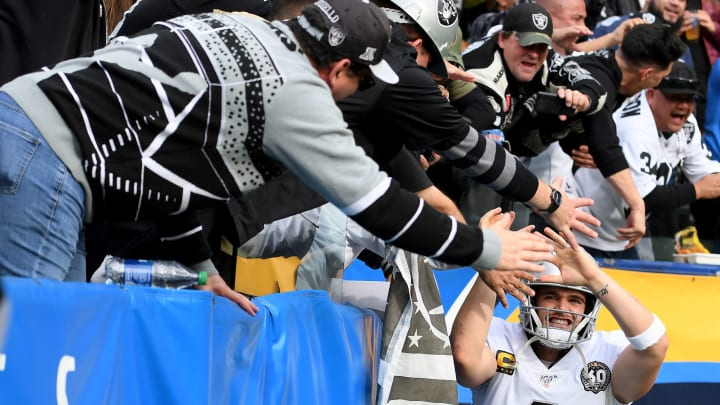Oakland Raiders fans celebrate with Derek Carr