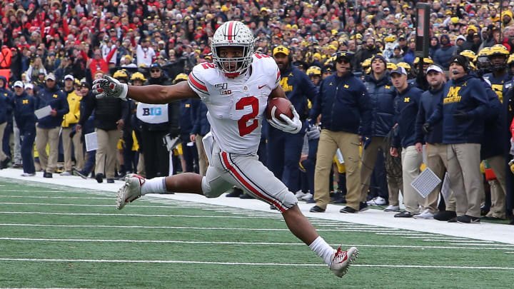 ANN ARBOR, MI - NOVEMBER 30: J.K. Dobbins #2 of the Ohio State Buckeyes runs for a first down during the first quarter of the game against the Michigan Wolverines at Michigan Stadium on November 30, 2019 in Ann Arbor, Michigan. (Photo by Leon Halip/Getty Images)