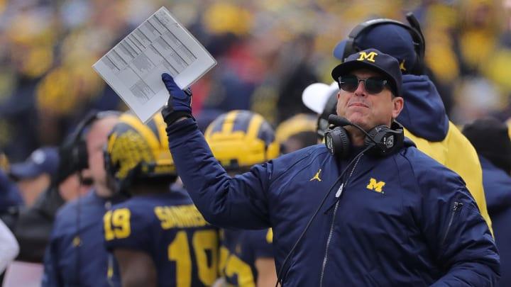 Jim Harbaugh coaches Michigan in a losing effort against Ohio State