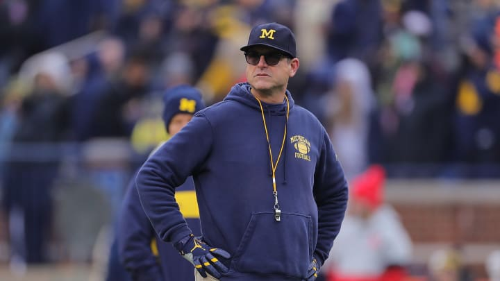 ANN ARBOR, MI - NOVEMBER 30: Michigan Wolverines Head Football Coach Jim Harbaugh watches the pregame warmups prior to the start of the game against the Ohio State Buckeyes at Michigan Stadium on November 30, 2019 in Ann Arbor, Michigan. (Photo by Leon Halip/Getty Images)