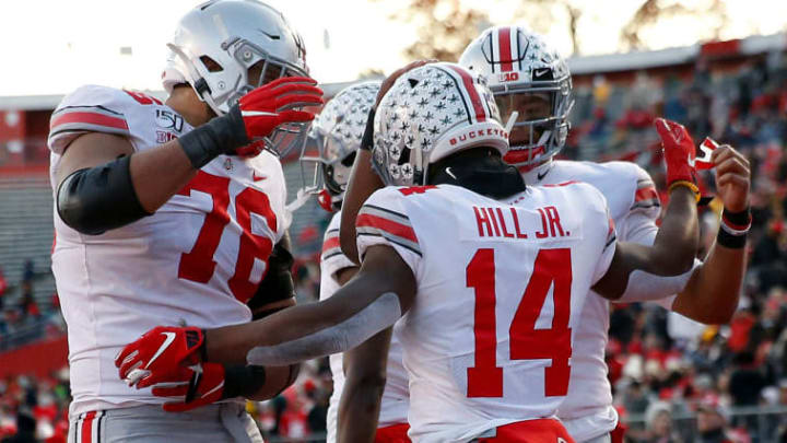 PISCATAWAY, NEW JERSEY - NOVEMBER 16:  K.J. Hill #14 of the Ohio State Buckeyes is congratulated by teammates Justin Fields #1 and Branden Bowen #76 after Hill scored a touchdown in the second quarter against the Rutgers Scarlet Knights at SHI Stadium on November 16, 2019 in Piscataway, New Jersey. (Photo by Elsa/Getty Images)