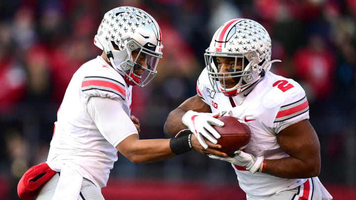 PISCATAWAY, NEW JERSEY - NOVEMBER 16: Justin Fields #1 hands off the ball to J.K. Dobbins #2 of the Ohio State Buckeyes during the first half of their game against the Ohio State Buckeyes at SHI Stadium on November 16, 2019 in Piscataway, New Jersey. (Photo by Emilee Chinn/Getty Images)