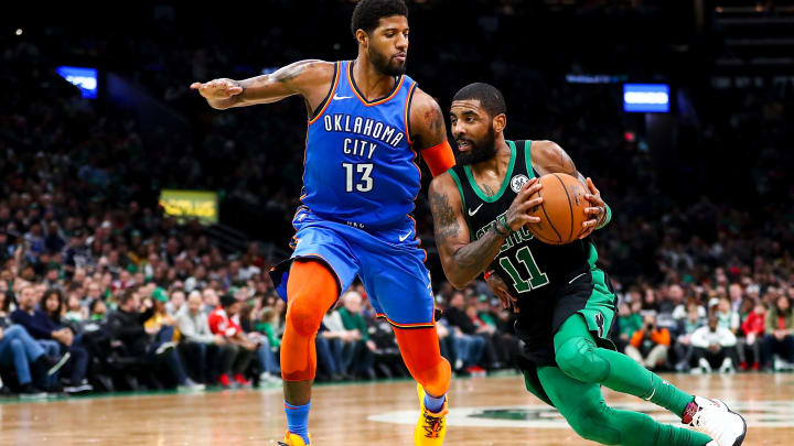 BOSTON, MA - FEBRUARY 03:  Kyrie Irving #11 of the Boston Celtics drives to the basket past Paul George #13 of the Oklahoma City Thunder during a game at TD Garden on February 3, 2019 in Boston, Massachusetts. NOTE TO USER: User expressly acknowledges and agrees that, by downloading and or using this photograph, User is consenting to the terms and conditions of the Getty Images License Agreement. (Photo by Adam Glanzman/Getty Images)