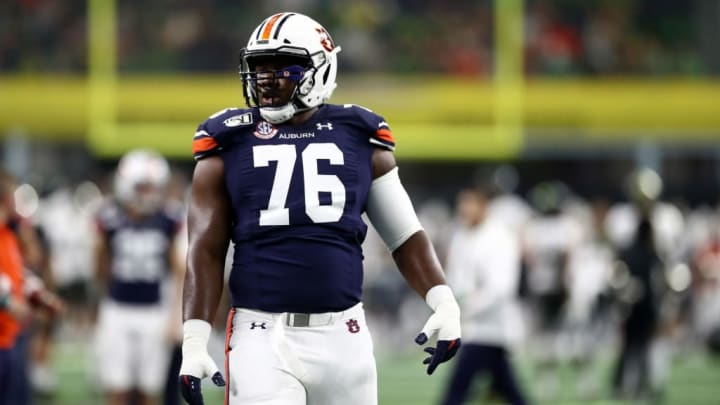 ARLINGTON, TEXAS - AUGUST 31:   Prince Tega Wanogho #76 of the Auburn Tigers during the Advocare Classic at AT&T Stadium on August 31, 2019 in Arlington, Texas. (Photo by Ronald Martinez/Getty Images)