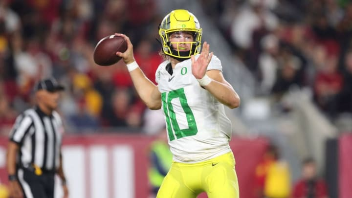 LOS ANGELES, CALIFORNIA - NOVEMBER 02:  Quarterback Justin Herbert #10 of the Oregon Ducks back to pass the ball against the USC Trojans at Los Angeles Memorial Coliseum on November 02, 2019 in Los Angeles, California. (Photo by Leon Bennett/Getty Images)